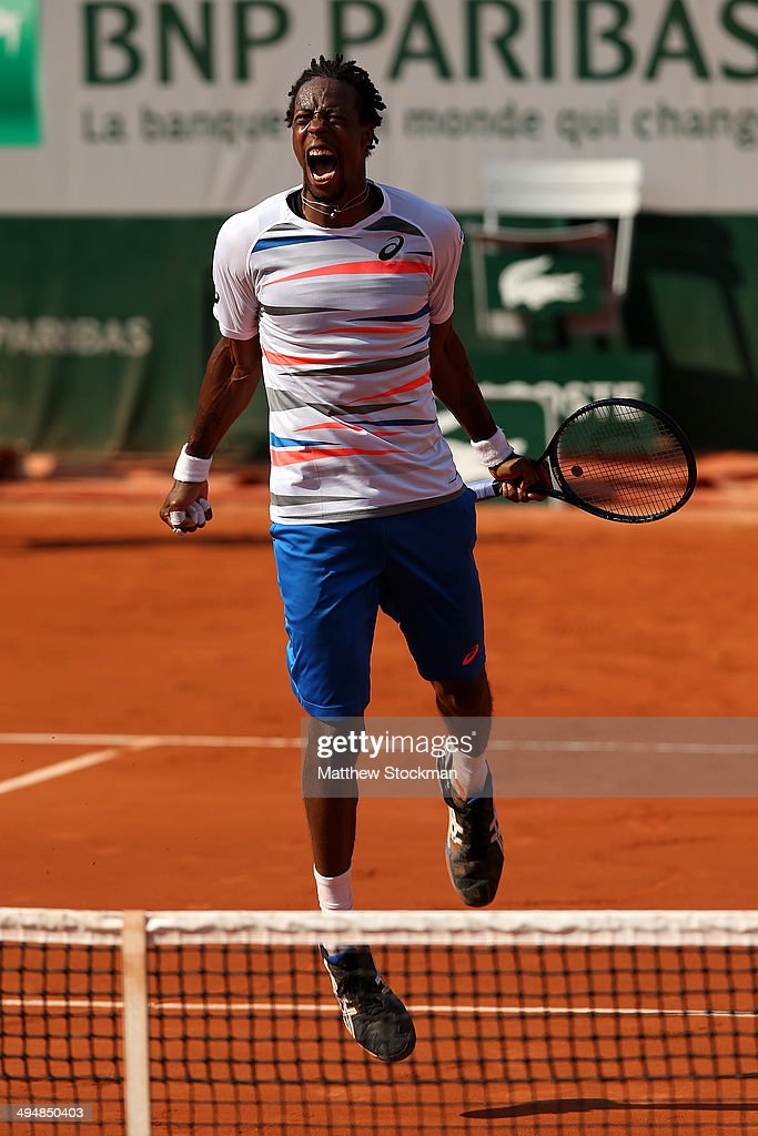 <a gi-track='captionPersonalityLinkClicked' href=/galleries/search?phrase=Gael+Monfils&family=editorial&specificpeople=213774 ng-click='$event.stopPropagation()'>Gael Monfils</a> of France celebrates victory during his men's singles match against Fabio Fognini of Italy on day seven of the French Open at Roland Garros on May 31, 2014 in Paris, France.