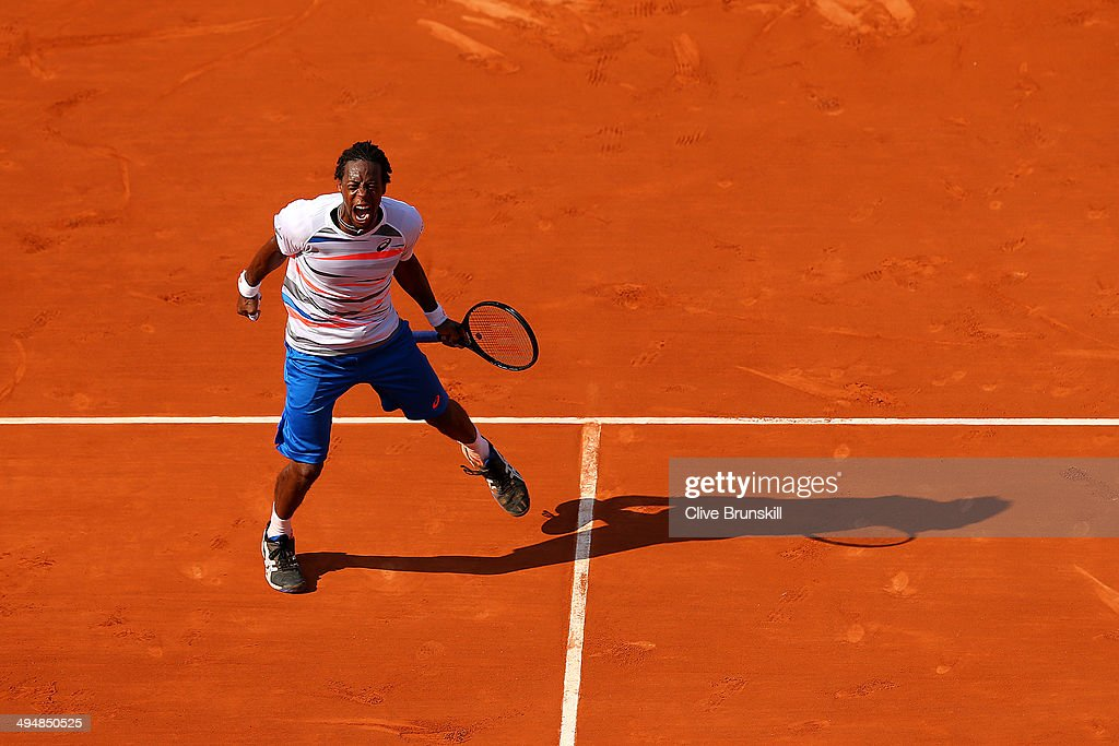 Gael Monfils of France celebrates victory during his men's singles match against Fabio Fognini of Italy on day seven of the French Open at Roland Garros on May 31, 2014 in Paris, France.