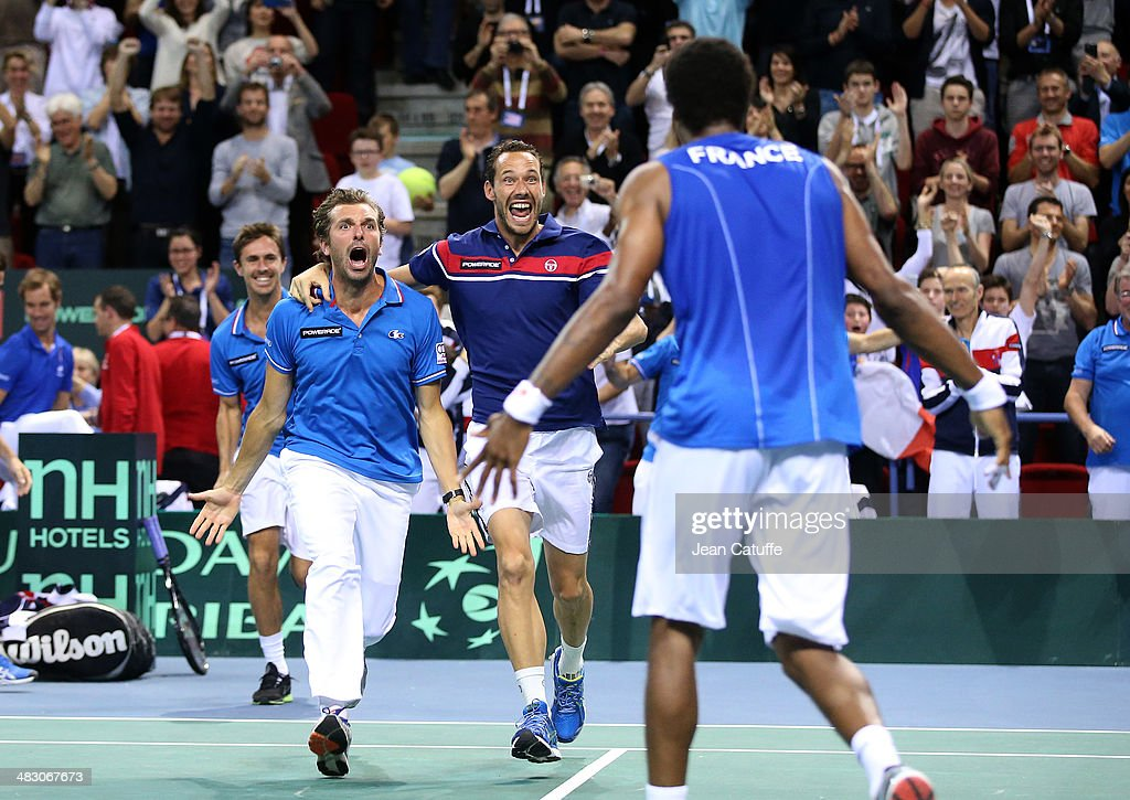 <a gi-track='captionPersonalityLinkClicked' href=/galleries/search?phrase=Gael+Monfils&family=editorial&specificpeople=213774 ng-click='$event.stopPropagation()'>Gael Monfils</a> of France celebrates with <a gi-track='captionPersonalityLinkClicked' href=/galleries/search?phrase=Julien+Benneteau&family=editorial&specificpeople=228097 ng-click='$event.stopPropagation()'>Julien Benneteau</a> and <a gi-track='captionPersonalityLinkClicked' href=/galleries/search?phrase=Michael+Llodra&family=editorial&specificpeople=208919 ng-click='$event.stopPropagation()'>Michael Llodra</a> the qualification of Team France after beating Peter Gojowczyk of Germany during the second round Davis Cup match between France and Germany at Palais des Sports Jean Weille stadium on April 6, 2014 in Nancy, France.