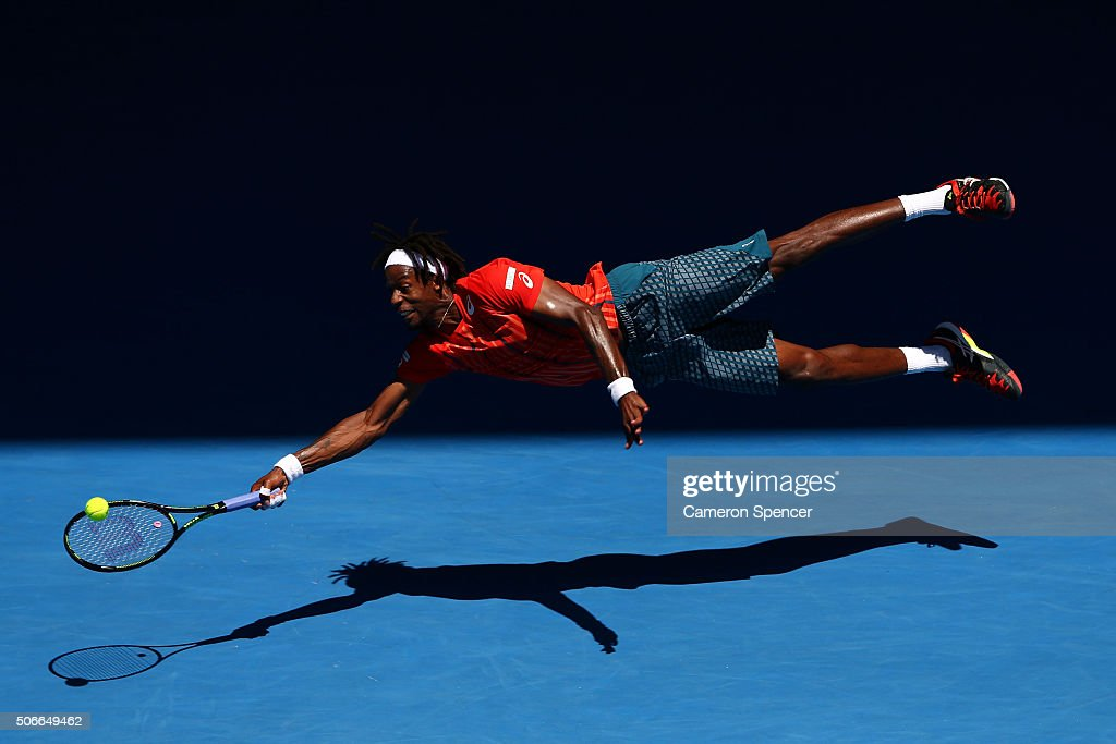 <a gi-track='captionPersonalityLinkClicked' href=/galleries/search?phrase=Gael+Monfils&family=editorial&specificpeople=213774 ng-click='$event.stopPropagation()'>Gael Monfils</a> of France dives for a forehand in his fourth round match against Andrey Kuznestov of Russia during day eight of the 2016 Australian Open at Melbourne Park on January 25, 2016 in Melbourne, Australia.