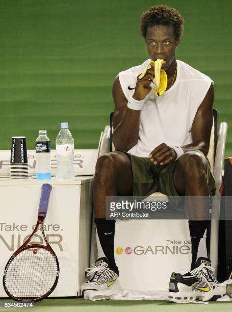Gael Monfils of France eats a banana during a changeover while playing against Marcos Baghdatis of Cyprus in their men's singles second round match...