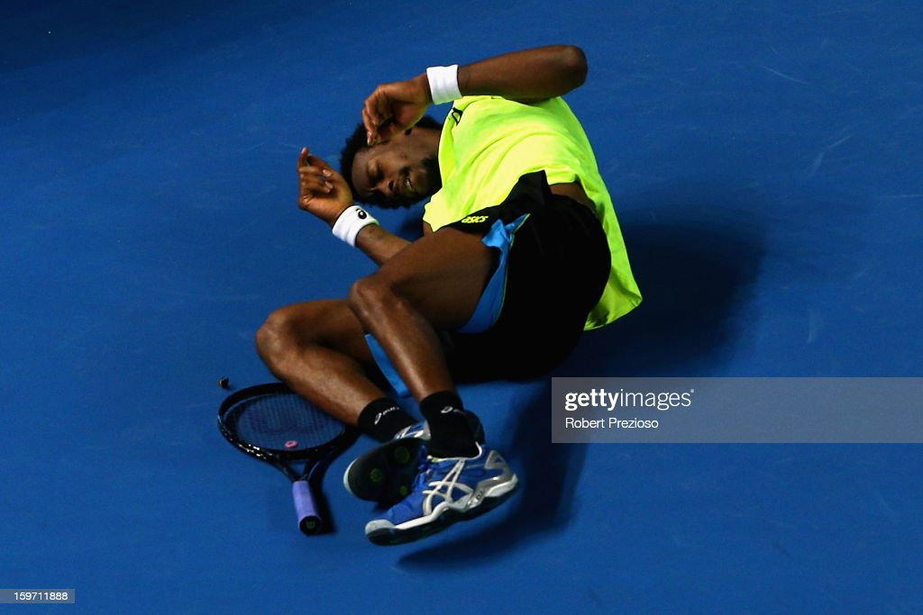 <a gi-track='captionPersonalityLinkClicked' href=/galleries/search?phrase=Gael+Monfils&family=editorial&specificpeople=213774 ng-click='$event.stopPropagation()'>Gael Monfils</a> of France falls over in his third round match against Gilles Simon of France during day six of the 2013 Australian Open at Melbourne Park on January 19, 2013 in Melbourne, Australia.