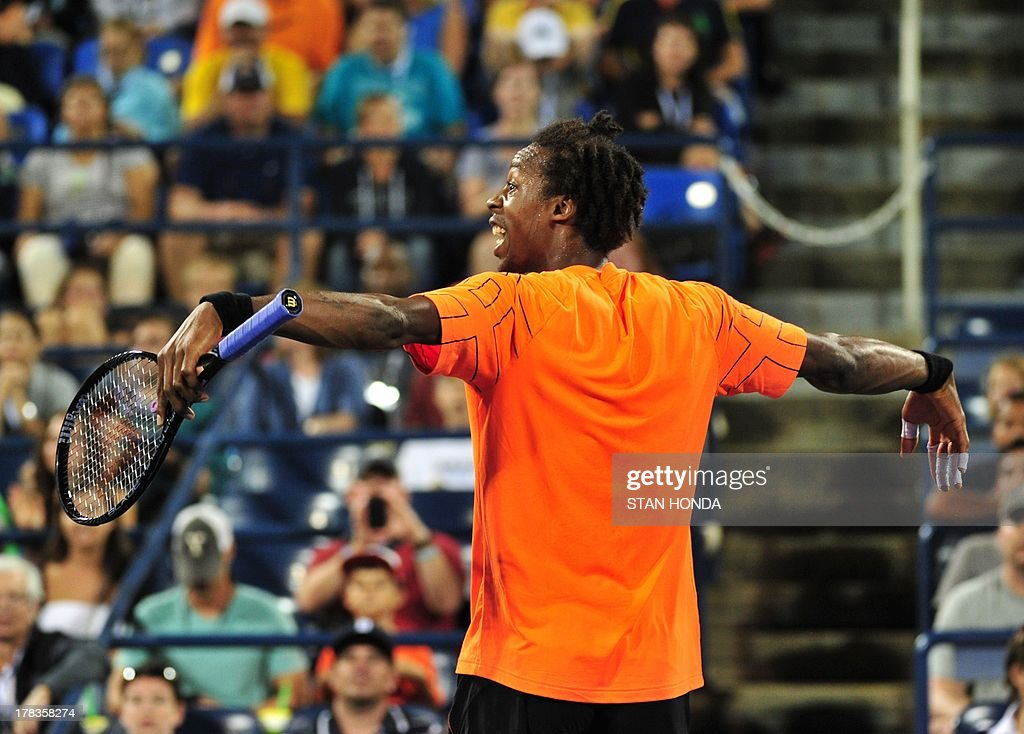 Gael Monfils of France gestures after a shot to John Isner of the US during their 2013 US Open men's singles match at the USTA Billie Jean King National Tennis Center August 29, 2013 in New York. AFP PHOTO/Stan HONDA