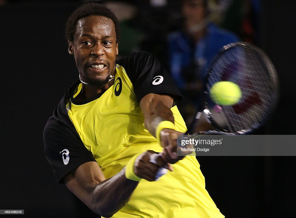 <a gi-track='captionPersonalityLinkClicked' href=/galleries/search?phrase=Gael+Monfils&family=editorial&specificpeople=213774 ng-click='$event.stopPropagation()'>Gael Monfils</a> of France hits a backhand in his third round match against <a gi-track='captionPersonalityLinkClicked' href=/galleries/search?phrase=Rafael+Nadal&family=editorial&specificpeople=194996 ng-click='$event.stopPropagation()'>Rafael Nadal</a> of Spain during day six of the 2014 Australian Open at Melbourne Park on January 18, 2014 in Melbourne, Australia.