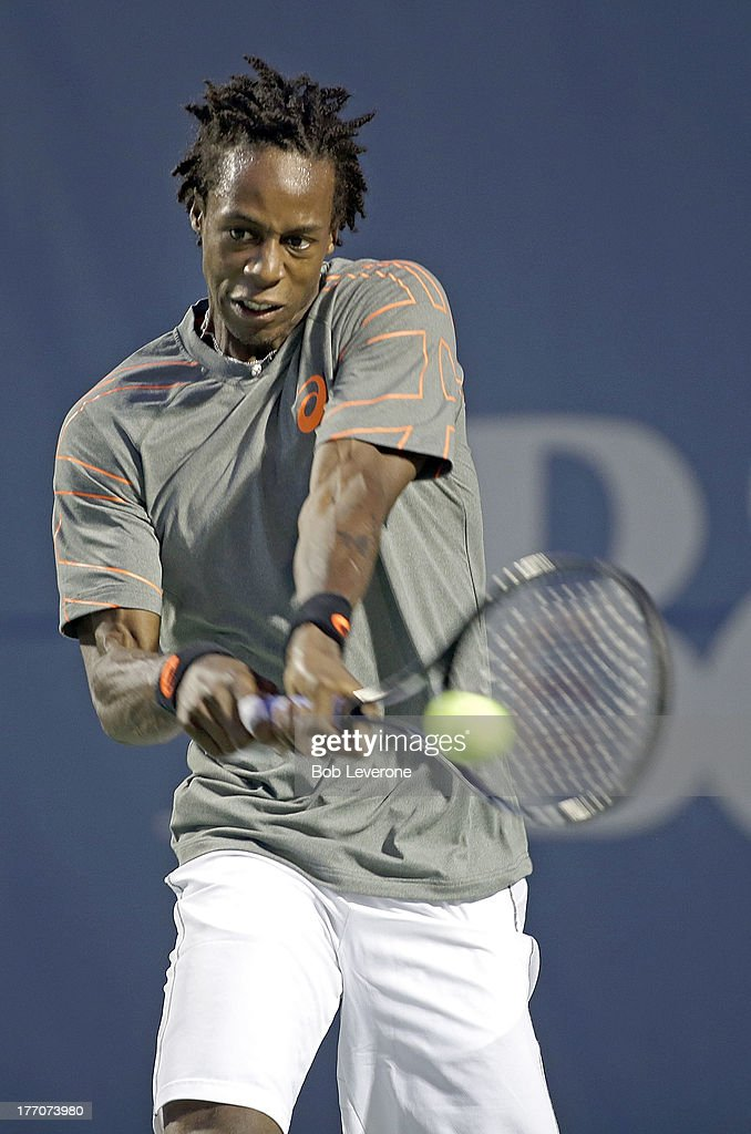 Gael Monfils of France hits a return against Guido Pella of Argentina on August 20, 2013 in Winston Salem, North Carolina.