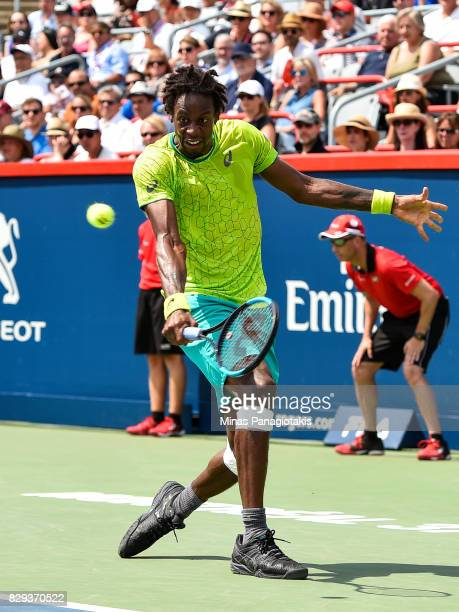 Gael Monfils of France hits a return against Roberto Bautista Agut of Spain in the men's singles match during day seven of the Rogers Cup presented...