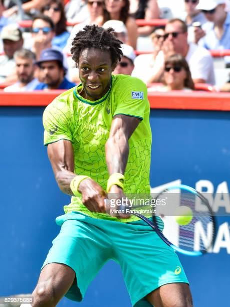 Gael Monfils of France hits a return against Roberto Bautista Agut of Spain during day seven of the Rogers Cup presented by National Bank at Uniprix...