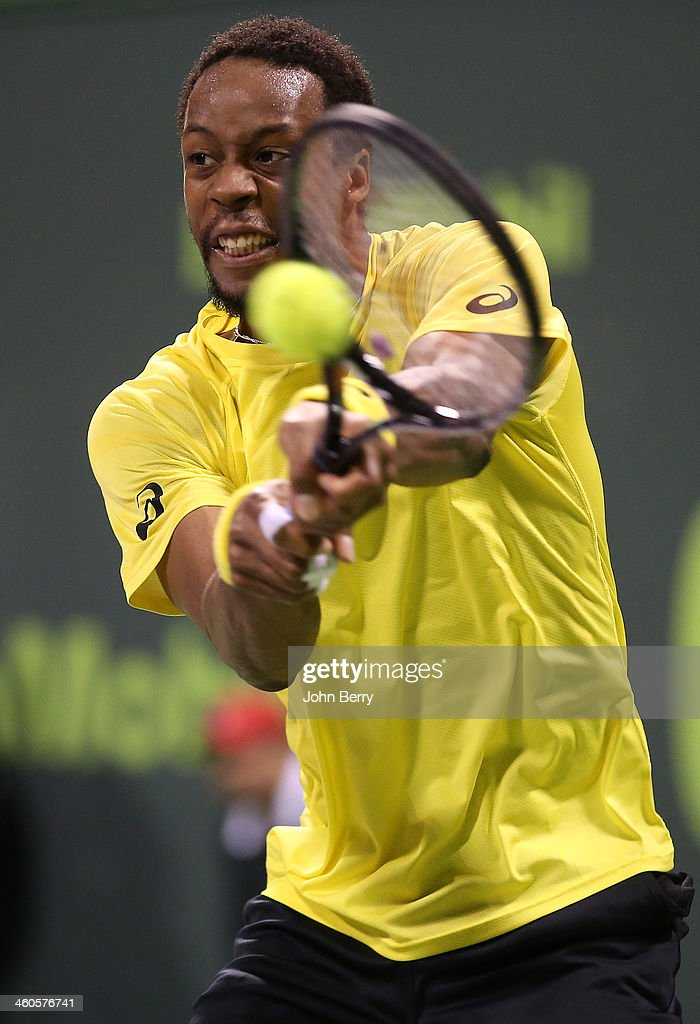 Gael Monfils of France in action against Rafael Nadal of Spain during the final of the Qatar ExxonMobil Open 2014 held at the Khalifa International...