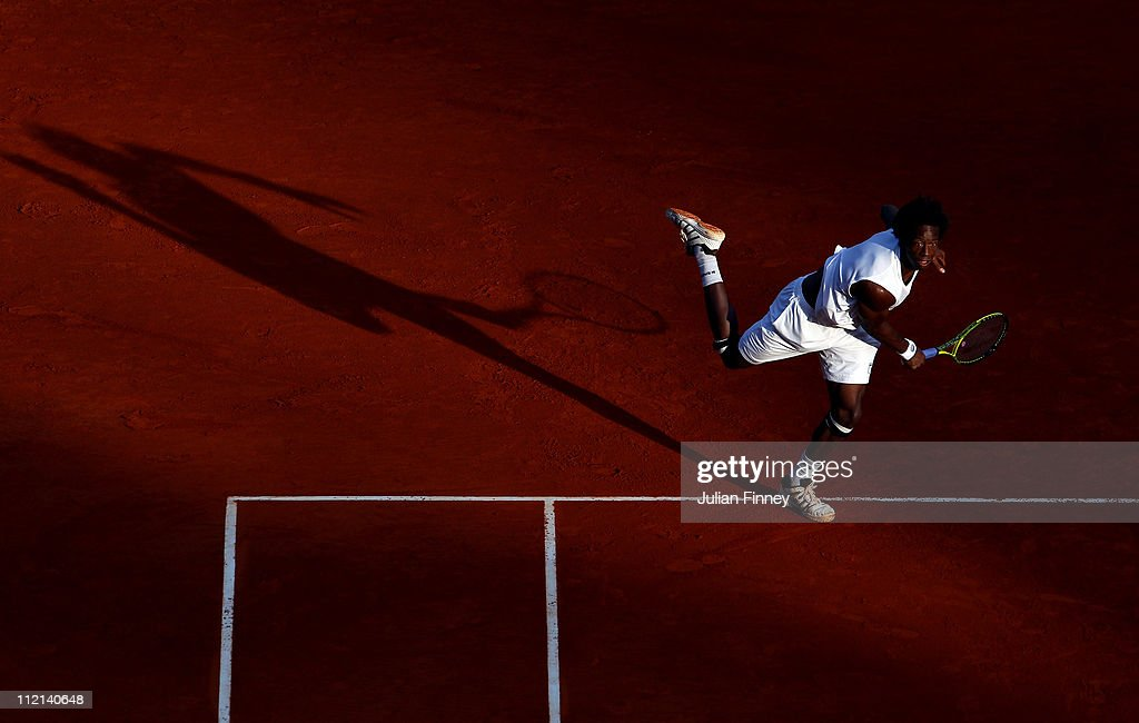 Gael Monfils of France in action with partner JoWilfried Tsonga of France in their doubles match against Lukas Dlouhy of Czech Republic and Janko...