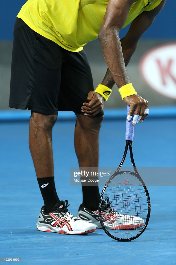 Gael Monfils of France leans his racquet on the court in his first round match against Ryan Harrison of the United States during day two of the 2014 Australian Open at Melbourne Park on January 14, 2014 in Melbourne, Australia.