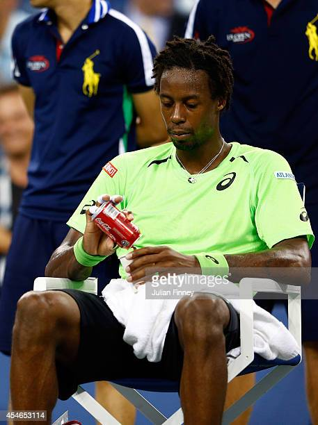 Gael Monfils of France looks on during a break in play against Roger Federer of Switzerland during their men's singles quarterfinal match on Day...