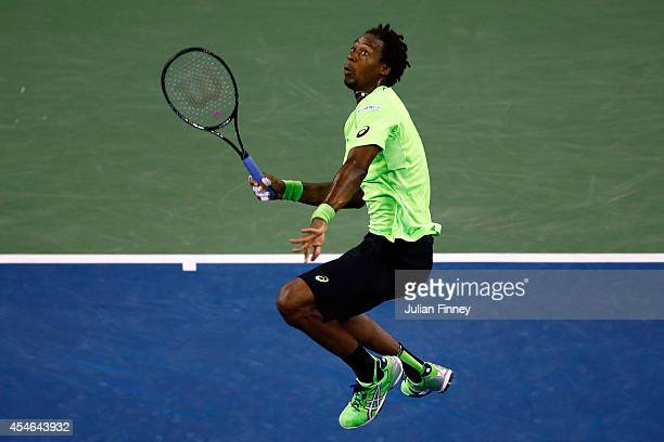 Gael Monfils of France looks to return a shot against Roger Federer of Switzerland during their men's singles quarterfinal match on Day Eleven of the...