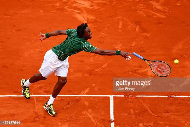 Gael Monfils of France loses his racquet as he stretches for a shot in his Men's Singles match against Pablo Cuevas of Uruguay on day six of the 2015...