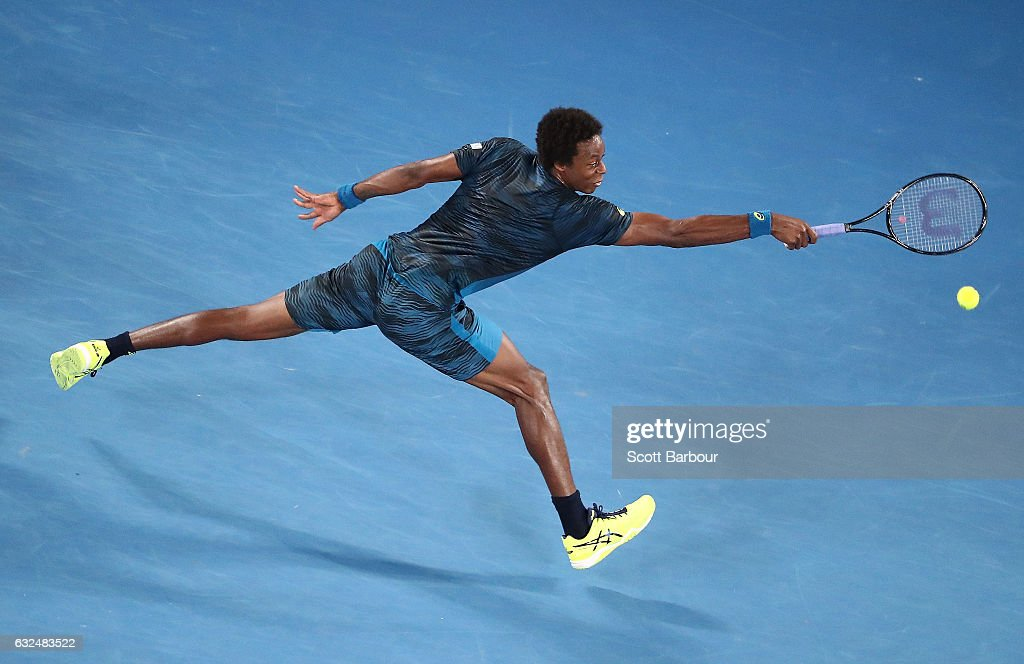 Gael Monfils of France plays a backhand in his fourth round match against Rafael Nadal of Spain on day eight of the 2017 Australian Open at Melbourne Park on January 23, 2017 in Melbourne, Australia.