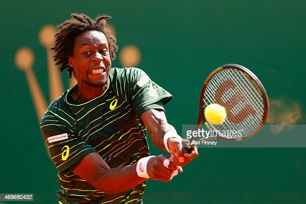 Gael Monfils of France plays a backhand in his match against Andrey Kuznetsov of Russia during day three of the Monte Carlo Rolex Masters tennis at...