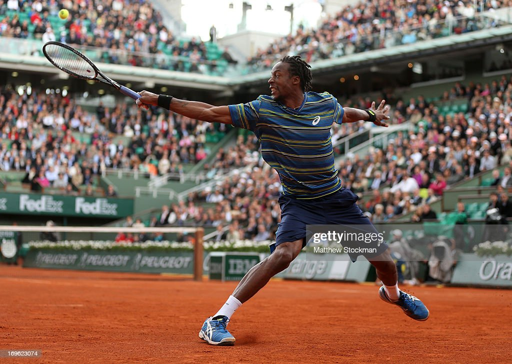 <a gi-track='captionPersonalityLinkClicked' href=/galleries/search?phrase=Gael+Monfils&family=editorial&specificpeople=213774 ng-click='$event.stopPropagation()'>Gael Monfils</a> of France plays a backhand in his Men's Singles match against Ernests Gulbis of Latvia during day four of the French Open at Roland Garros on May 29, 2013 in Paris, France.