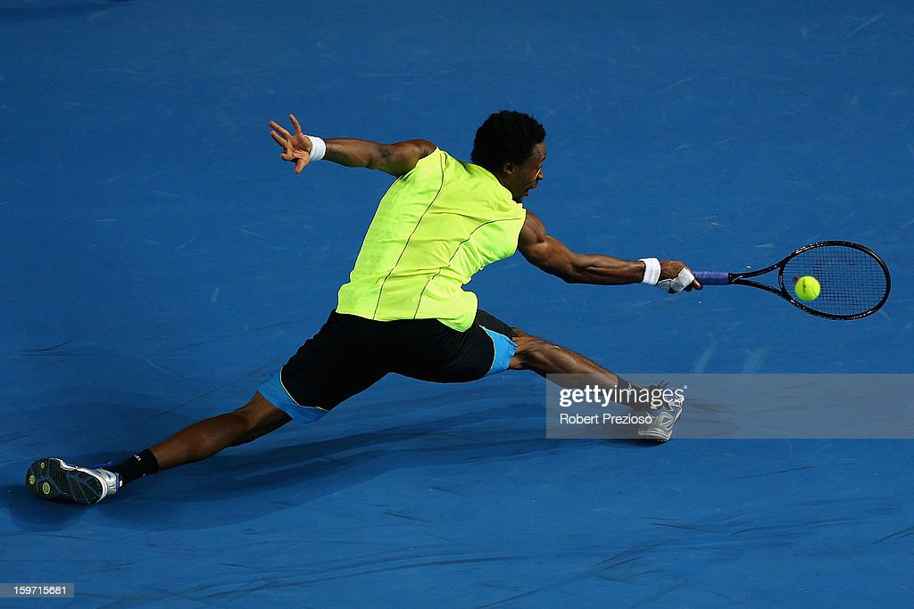 Gael Monfils of France plays a backhand in his third round match against Gilles Simon of France during day six of the 2013 Australian Open at Melbourne Park on January 19, 2013 in Melbourne, Australia.