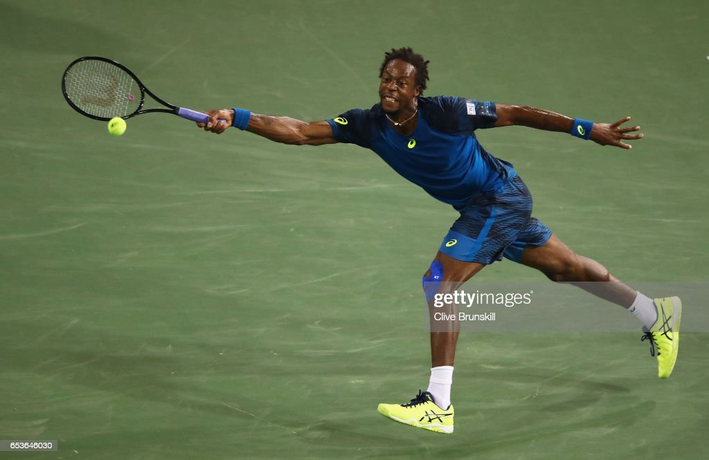 Gael Monfils of France plays a forehand against Dominic Thiem of Austria in their fourth round match during day ten of the BNP Paribas Open at Indian Wells Tennis Garden on March 15, 2017 in Indian Wells, California.