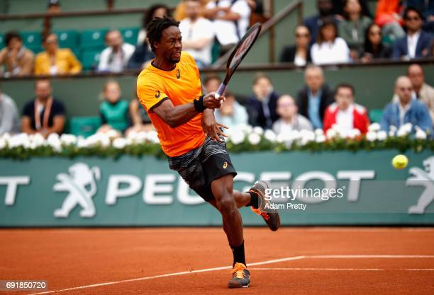 Gael Monfils of France plays a forehand during the mens singles third round match against Richard Gasquet of France on day seven of the 2017 French...