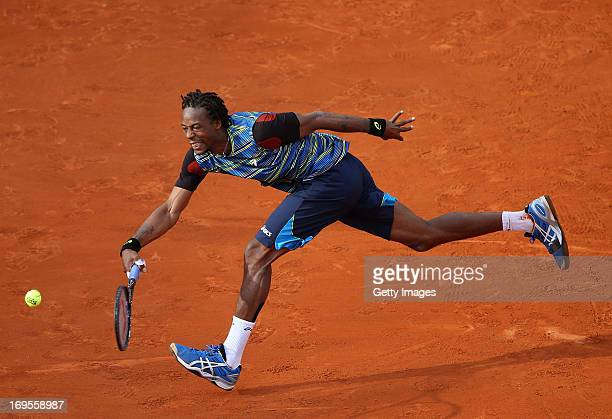 Gael Monfils of France plays a forehand in his Men's Singles match against Tomas Berdych of Czech Republic during day two of the French Open at...