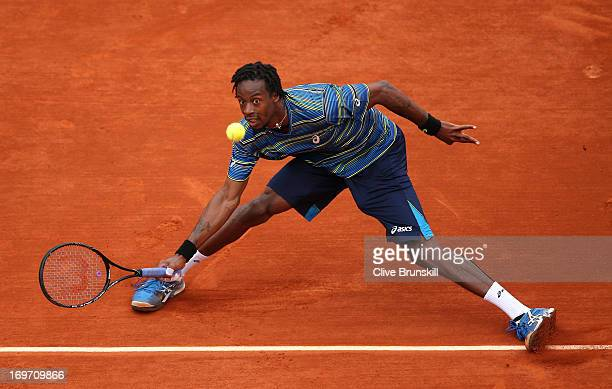 Gael Monfils of France plays a forehand in his Men's Singles match against Tommy Robredo of Spain during day six of the French Open at Roland Garros...