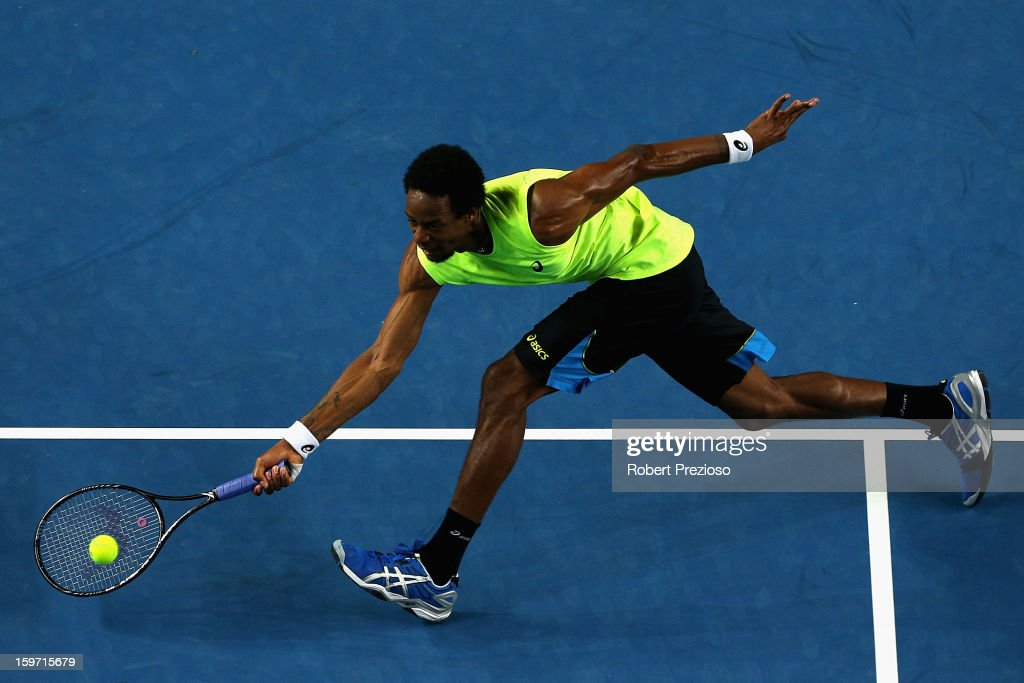 Gael Monfils of France plays a forehand in his third round match against Gilles Simon of France during day six of the 2013 Australian Open at Melbourne Park on January 19, 2013 in Melbourne, Australia.