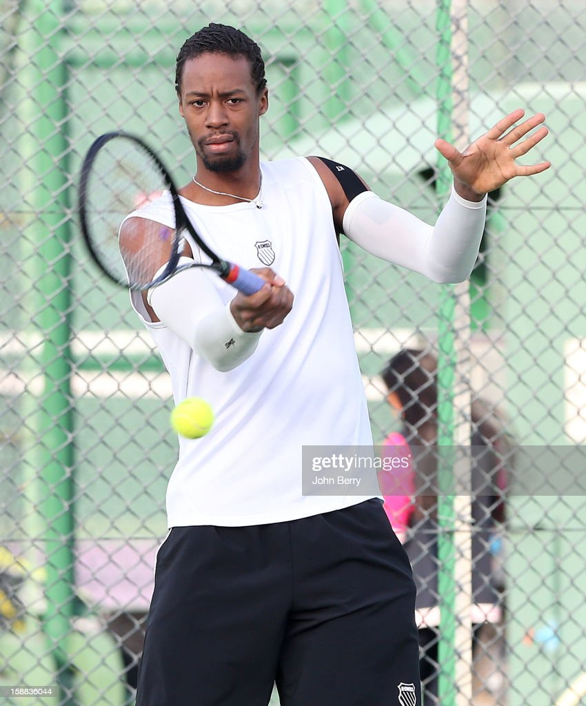 Gael Monfils of France plays a shot during a practice session with Michal Przysiezny of Poland during Day One of the Qatar Open 2013, first tournament of the ATP World Tour 2013, held at the Khalifa International Tennis and Squash Complex on December 31, 2012 in Doha, Qatar.
