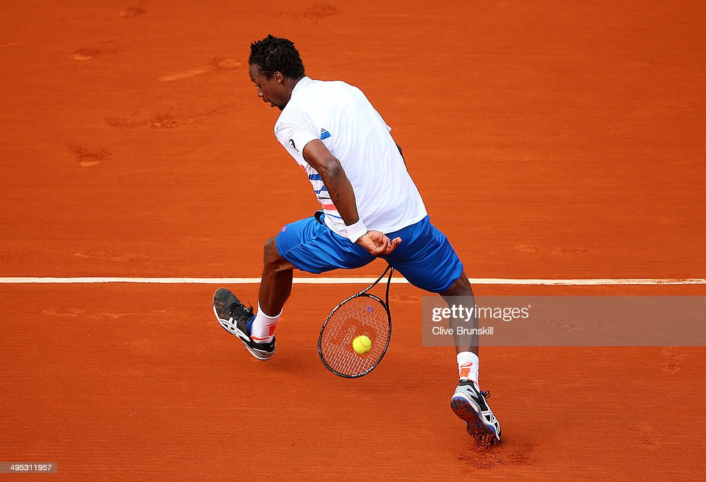 <a gi-track='captionPersonalityLinkClicked' href=/galleries/search?phrase=Gael+Monfils&family=editorial&specificpeople=213774 ng-click='$event.stopPropagation()'>Gael Monfils</a> of France plays a shot through his legs during his men's singles match against Guillermo Garcia-Lopez of Spain on day nine of the French Open at Roland Garros on June 2, 2014 in Paris, France.