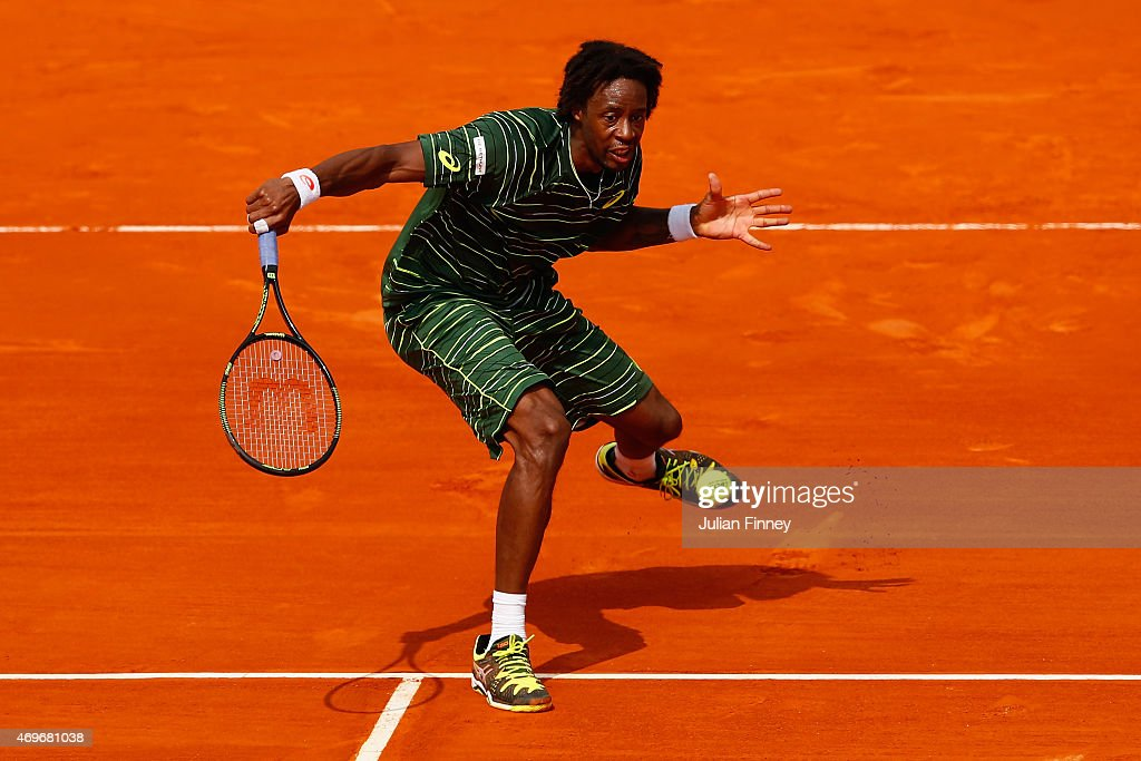 Gael Monfils of France plays a volley in his match against Andrey Kuznetsov of Russia during day three of the Monte Carlo Rolex Masters tennis at the...