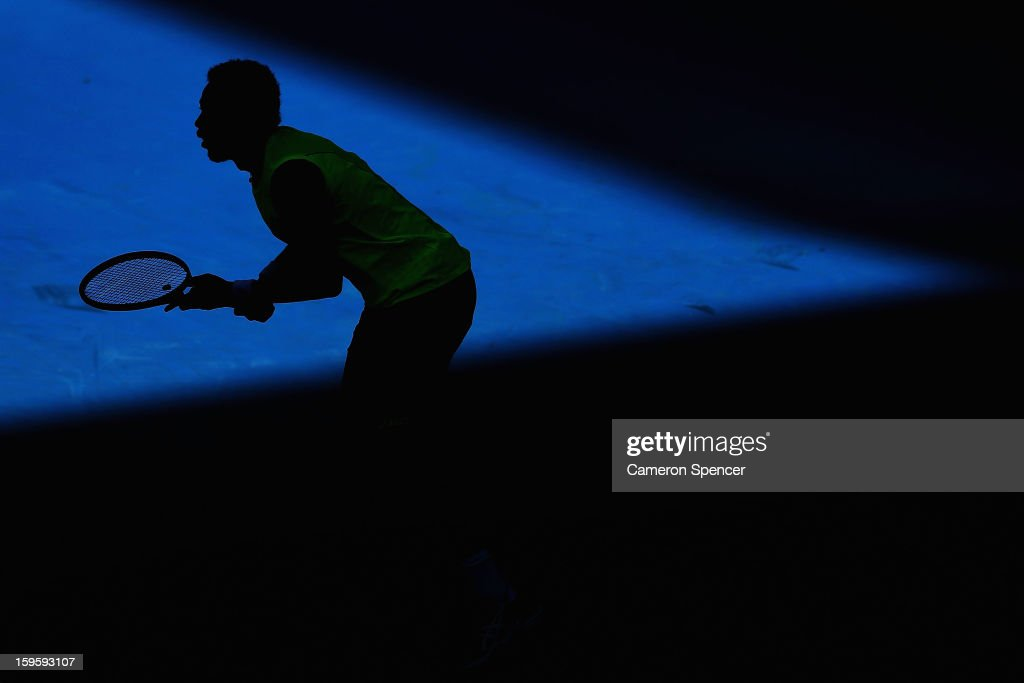 <a gi-track='captionPersonalityLinkClicked' href=/galleries/search?phrase=Gael+Monfils&family=editorial&specificpeople=213774 ng-click='$event.stopPropagation()'>Gael Monfils</a> of France prepares to return serve in his second round match against Yen-Hsun Lu of Chinese Taipei during day four of the 2013 Australian Open at Melbourne Park on January 17, 2013 in Melbourne, Australia.
