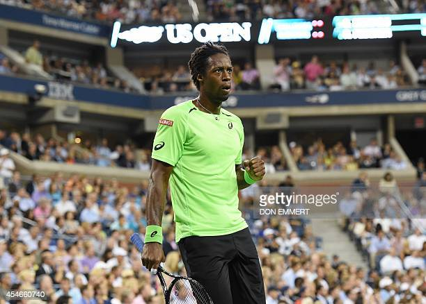 Gael Monfils of France pumps his fist after a point against Roger Federer of Switzerland during their US Open 2014 men's singles quarterfinals match...