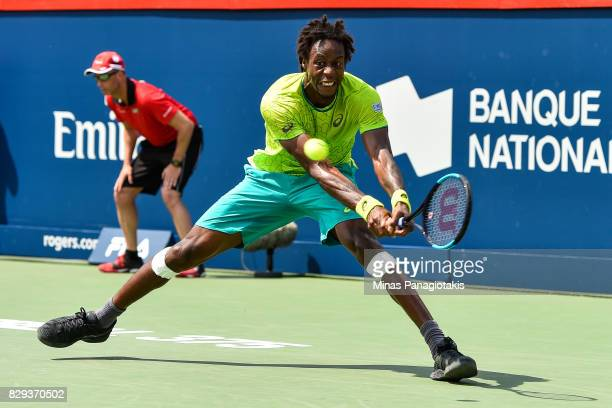 Gael Monfils of France reaches for the ball against Roberto Bautista Agut of Spain in the men's singles match during day seven of the Rogers Cup...