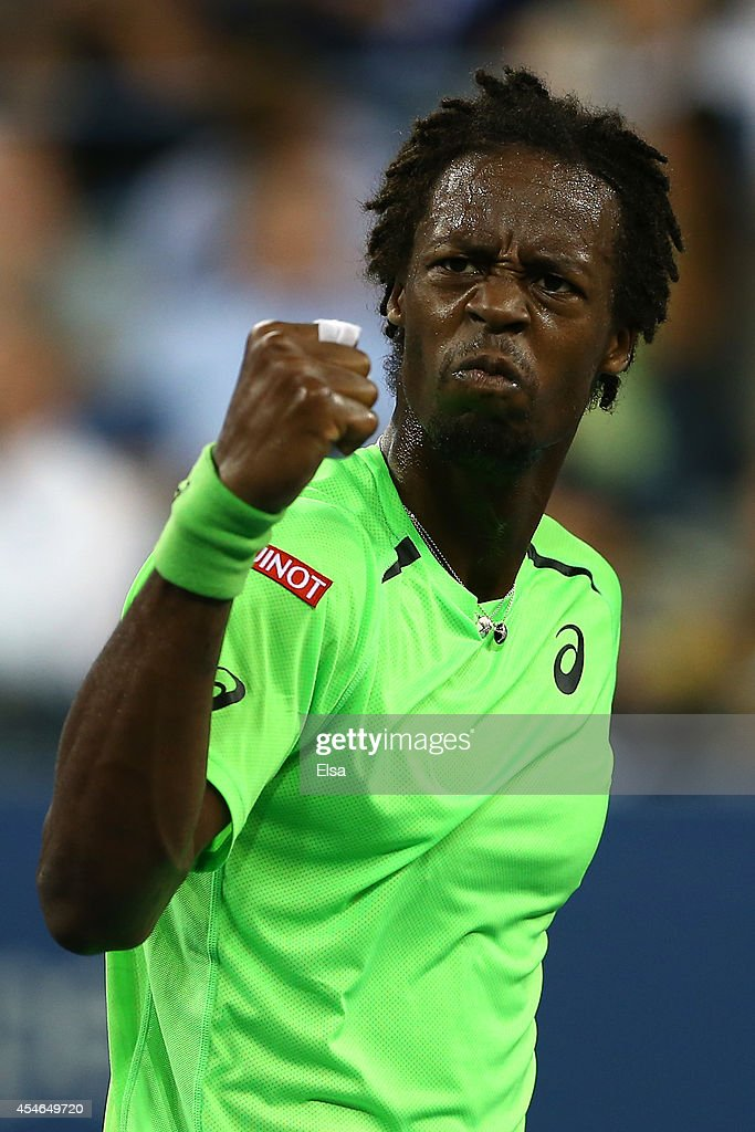 <a gi-track='captionPersonalityLinkClicked' href=/galleries/search?phrase=Gael+Monfils&family=editorial&specificpeople=213774 ng-click='$event.stopPropagation()'>Gael Monfils</a> of France reacts a point in the fourth set while playing Roger Federer of Switzerland during their men's singles quarterfinal match on Day Eleven of the 2014 US Open at the USTA Billie Jean King National Tennis Center on September 3, 2014 in the Flushing neighborhood of the Queens borough of New York City.