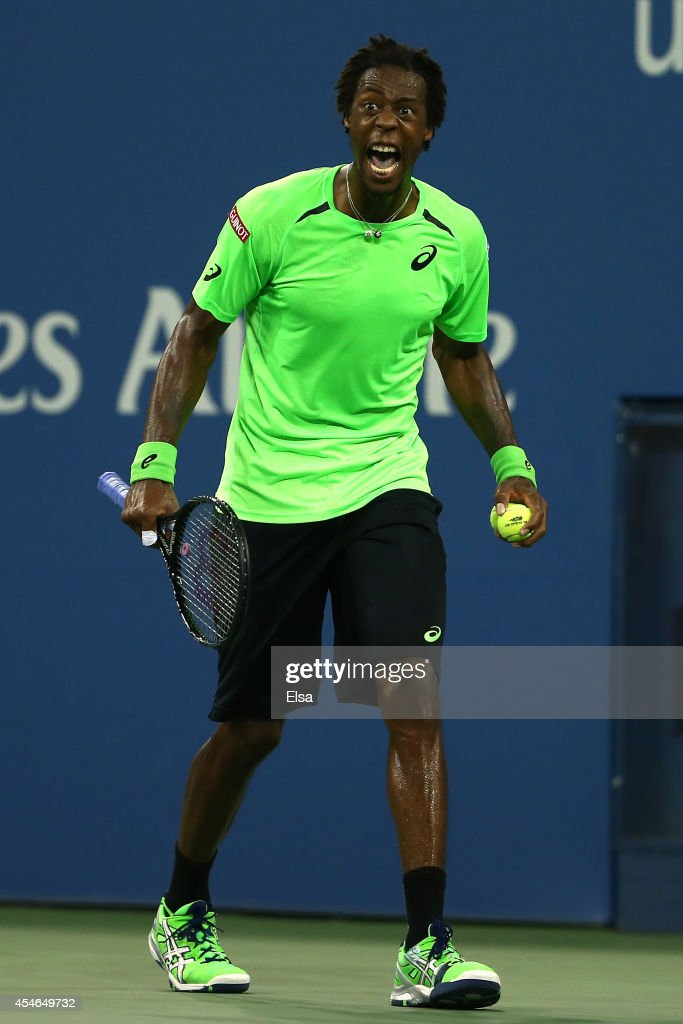 Gael Monfils of France reacts a point in the fourth set while playing Roger Federer of Switzerland during their men's singles quarterfinal match on Day Eleven of the 2014 US Open at the USTA Billie Jean King National Tennis Center on September 3, 2014 in the Flushing neighborhood of the Queens borough of New York City.