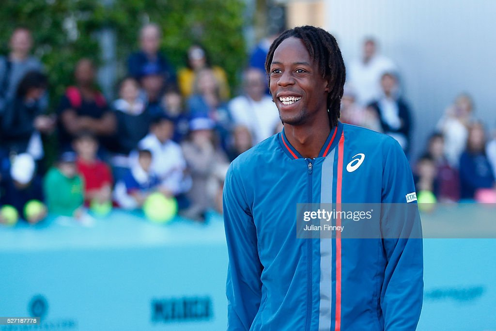 <a gi-track='captionPersonalityLinkClicked' href=/galleries/search?phrase=Gael+Monfils&family=editorial&specificpeople=213774 ng-click='$event.stopPropagation()'>Gael Monfils</a> of France reacts after hitting with sponsors during day three of the Mutua Madrid Open tennis tournament at the Caja Magica on May 02, 2016 in Madrid, Spain.