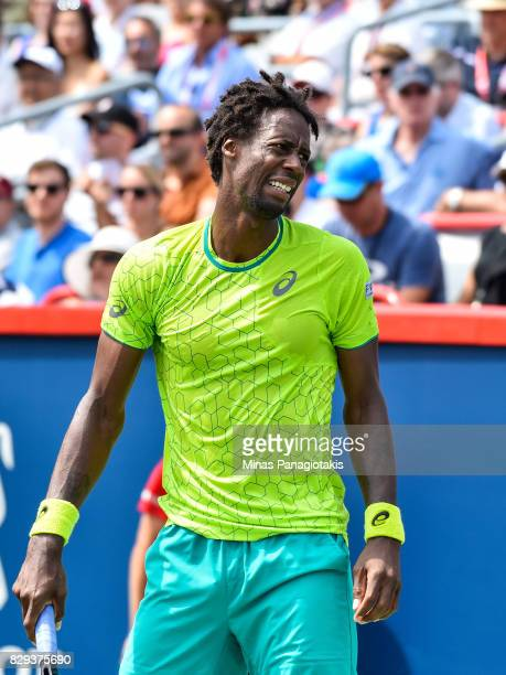 Gael Monfils of France reacts after losing a point against Roberto Bautista Agut of Spain during day seven of the Rogers Cup presented by National...