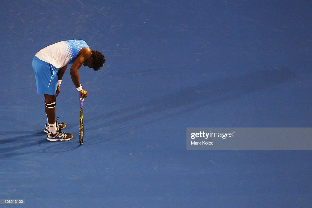 Gael Monfils of France reacts after match point in his third round match against Stanislas Wawrinka of Switzerland during day five of the 2011 Australian Open at Melbourne Park on January 21, 2011 in Melbourne, Australia.