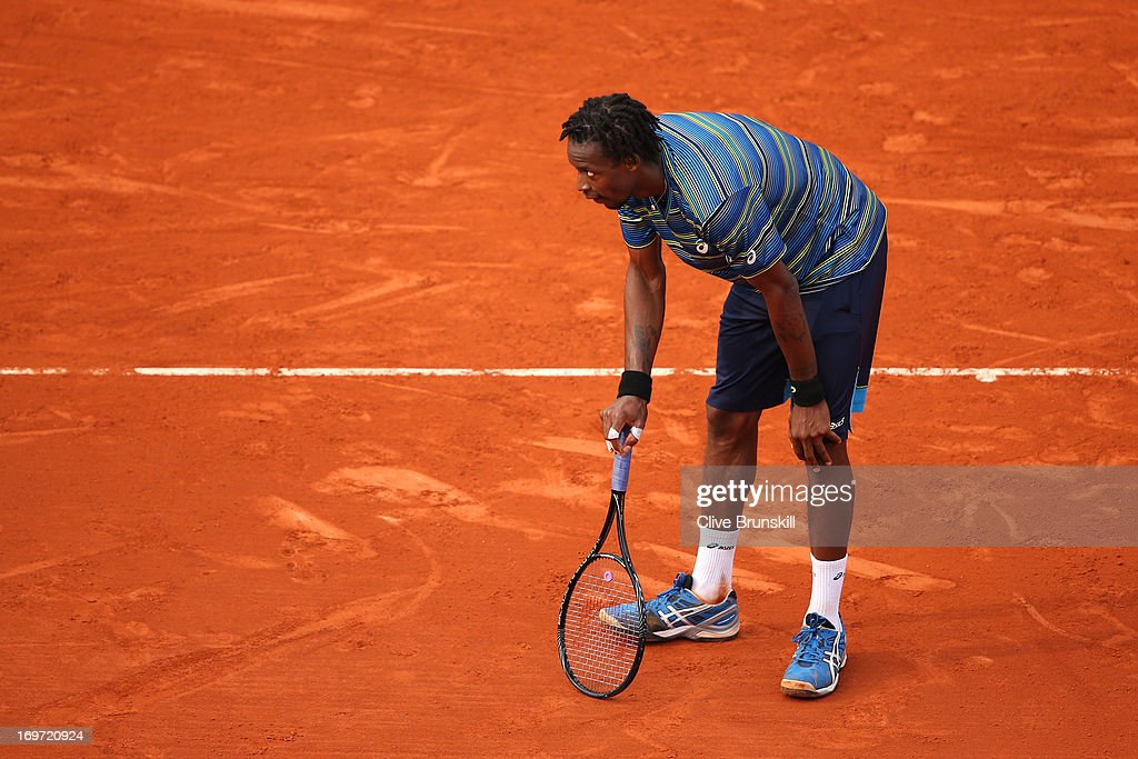 <a gi-track='captionPersonalityLinkClicked' href=/galleries/search?phrase=Gael+Monfils&family=editorial&specificpeople=213774 ng-click='$event.stopPropagation()'>Gael Monfils</a> of France reacts during his Men's Singles match against Tommy Robredo of Spain during day six of the French Open at Roland Garros on May 31, 2013 in Paris, France.