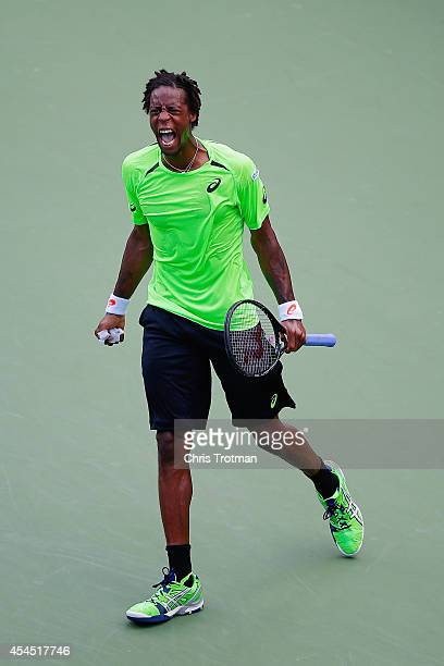 Gael Monfils of France reacts to a point while playing against Grigor Dimitrov of Bulgaria in their men's singles fourth round match on Day Nine of...