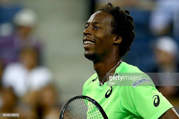 Gael Monfils of France reacts to a shot while playing Roger Federer of Switzerland during their men's singles quarterfinal match on Day Eleven of the...
