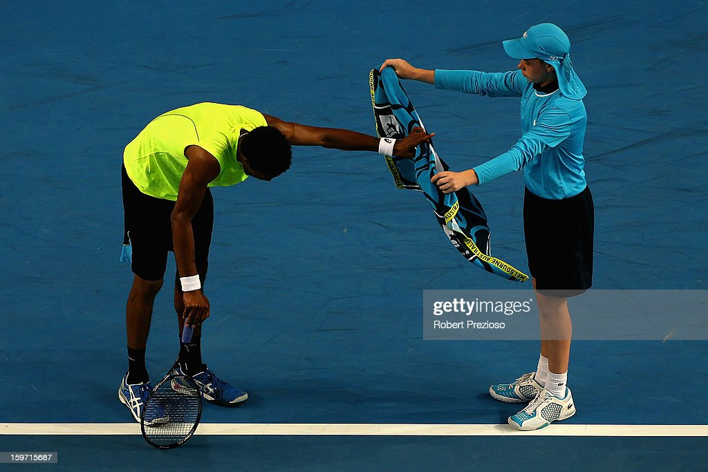 Gael Monfils of France rests in his third round match against Gilles Simon of France during day six of the 2013 Australian Open at Melbourne Park on January 19, 2013 in Melbourne, Australia.