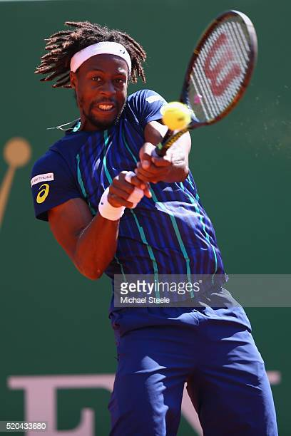 Gael Monfils of France returns a backhand during his match against Gilles Muller of Luxemburg during day two of the Monte Carlo Rolex Masters at...