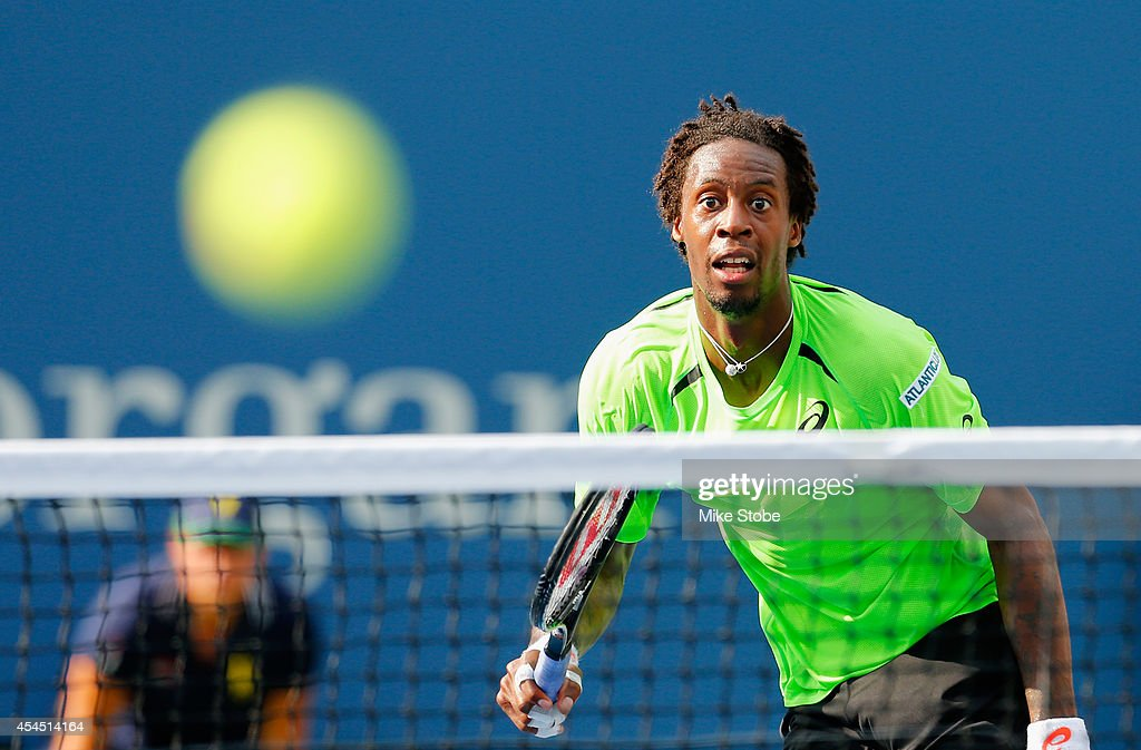 <a gi-track='captionPersonalityLinkClicked' href=/galleries/search?phrase=Gael+Monfils&family=editorial&specificpeople=213774 ng-click='$event.stopPropagation()'>Gael Monfils</a> of France returns a shot against Grigor Dimitrov of Bulgaria in their men's singles fourth round match on Day Nine of the 2014 US Open at the USTA Billie Jean King National Tennis Center on September 2, 2014 in the Flushing neighborhood of the Queens borough of New York City.