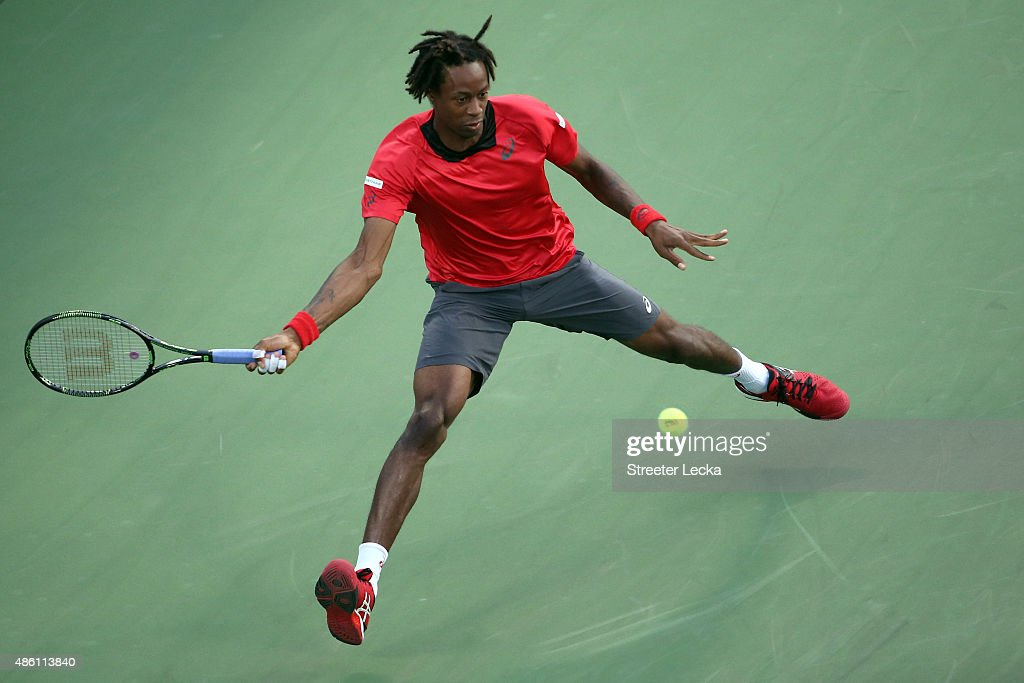 Gael Monfils of France returns a shot against Illya Marchenko of Ukraine during their Men's Singles First Round match on Day One of the 2015 US Open at the USTA Billie Jean King National Tennis Center on August 31, 2015 in the Flushing neighborhood of the Queens borough of New York City.