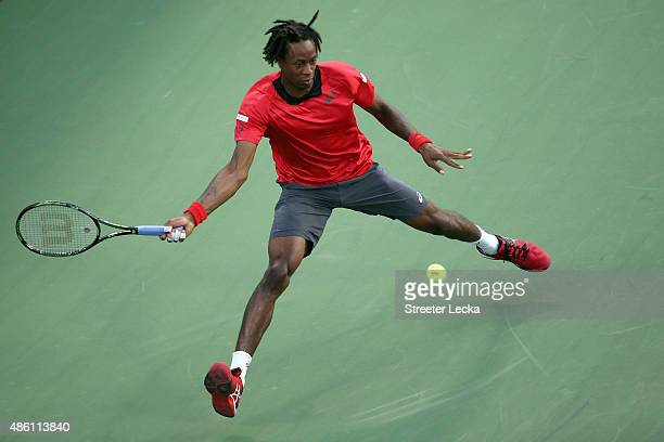Gael Monfils of France returns a shot against Illya Marchenko of Ukraine during their Men's Singles First Round match on Day One of the 2015 US Open...