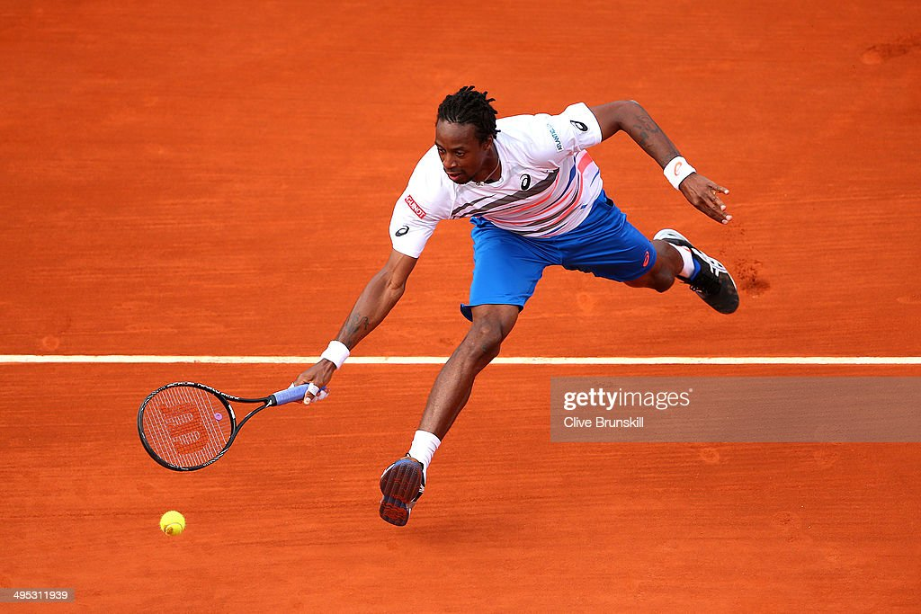 <a gi-track='captionPersonalityLinkClicked' href=/galleries/search?phrase=Gael+Monfils&family=editorial&specificpeople=213774 ng-click='$event.stopPropagation()'>Gael Monfils</a> of France returns a shot during his men's singles match against Guillermo Garcia-Lopez of Spain on day nine of the French Open at Roland Garros on June 2, 2014 in Paris, France.