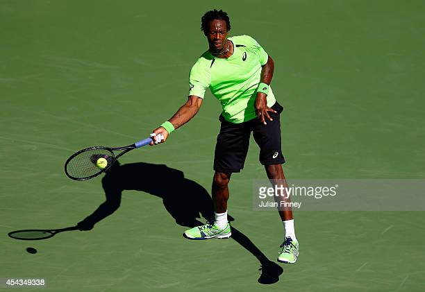 Gael Monfils of France returns a shot to Alejandro Gonzalez of Columbia during their men's singles second round match on Day Five of the 2014 US Open...
