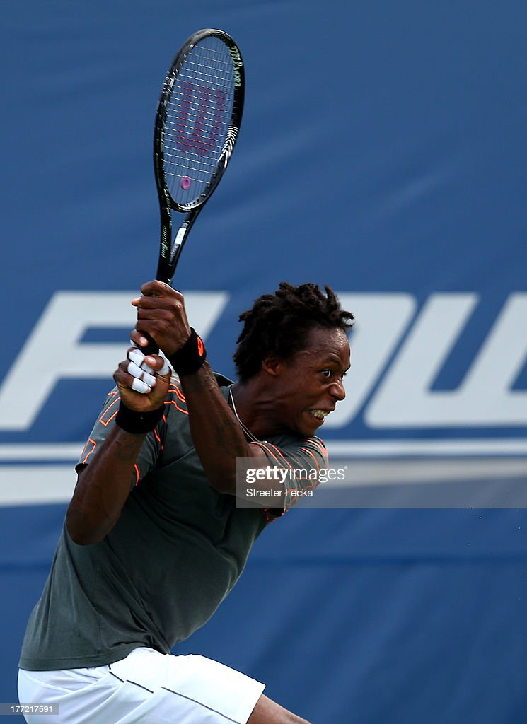 Gael Monfils of France returns a shot to Fernando Verdasco of Spain in the quarterfinals match during day 5 of the Winston-Salem Open at Wake Forest University on August 22, 2013 in Winston Salem, North Carolina.