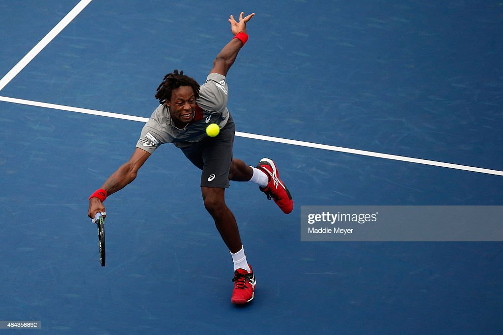 <a gi-track='captionPersonalityLinkClicked' href=/galleries/search?phrase=Gael+Monfils&family=editorial&specificpeople=213774 ng-click='$event.stopPropagation()'>Gael Monfils</a> of France returns a shot to Jerzy Janowicz of Poland during Day 3 of the Western & Southern Open at the Linder Family Tennis Center on August 17, 2015 in Cincinnati, Ohio.