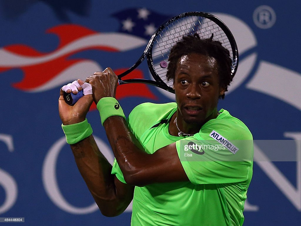 <a gi-track='captionPersonalityLinkClicked' href=/galleries/search?phrase=Gael+Monfils&family=editorial&specificpeople=213774 ng-click='$event.stopPropagation()'>Gael Monfils</a> of France returns a shot to Richard Gasquet of France on Day Seven of the 2014 US Open at the USTA Billie Jean King National Tennis Center on August 31, 2014 in the Flushing neighborhood of the Queens borough of New York City.
